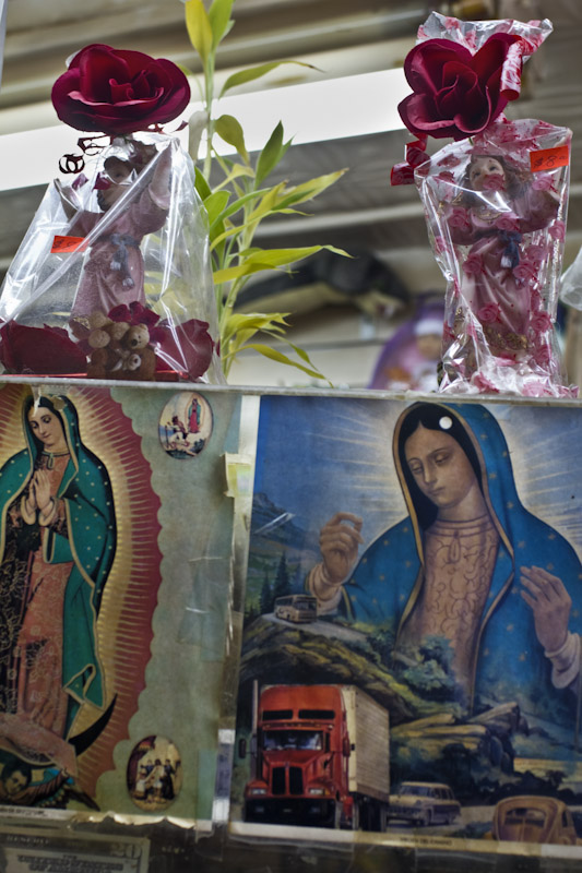 Mott Haven, NY : A poster of the Virgin of Guadalupe, Virgin Mary in a bakery.